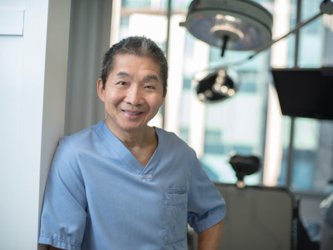 Jerry Wong posing at Vancouver hair transplant clinic